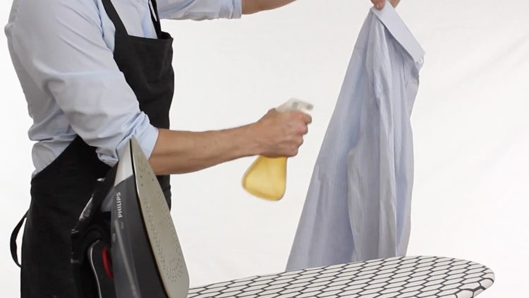 How to Iron Shirts spritzing shirt with water